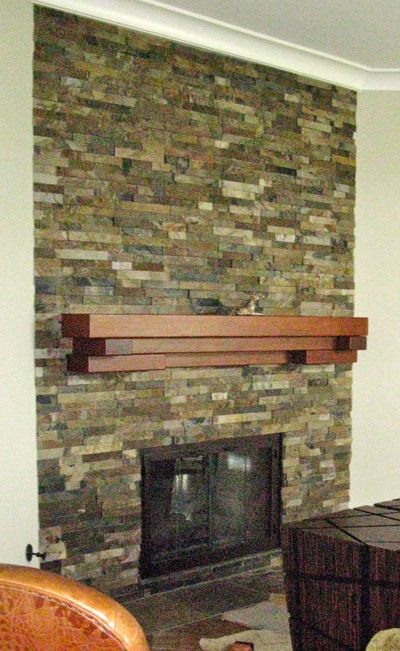 Floating Mantel Stacked Stone Fireplace